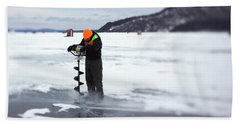 A Ice Fisherman Uses An Auger To Drill Beach Towel