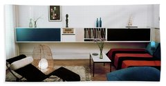A Living Room With A Le Corbusier Chair Beach Towel
