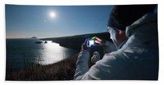A Man Captures The Full Moon Beach Towel