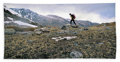 A Man Hikes Towards Mt. Neva 12,814 Ft Beach Towel