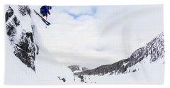 A Man Skis Deep Powder On A Stormy Day Beach Towel