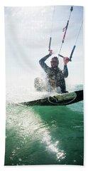 A Mid Adult Man Kitesurfs The Ocean Beach Towel
