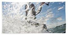 A Mid Adult Man Makes A Splash While Beach Towel