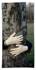 A Model Hugging A Tree Beach Towel