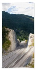 A Road Cut On The Trans Canada Highway Beach Towel
