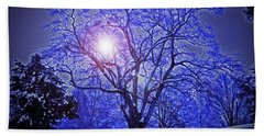 A Snow Glow Evening Beach Towel by Lydia Holly