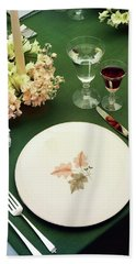 A Table Setting On A Green Tablecloth Beach Towel
