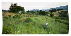 A Trail Runner Crosses Through Green Beach Towel