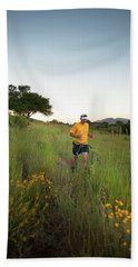 A Trail Runner Passes Wildflowers Beach Towel