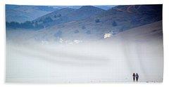 A Walk In The Evening Fog Beach Towel by AJ  Schibig