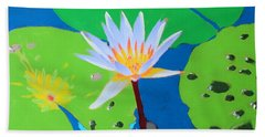 A Water Lily In Its Pad Beach Towel