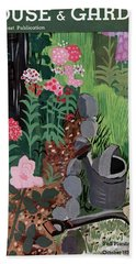 A Watering Can And A Shovel By A Flower Bed Beach Towel