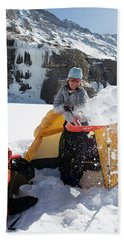 A Woman Shovelling Snow Away Beach Towel