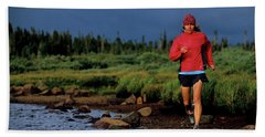 A Woman Trail Runs At Brainard Lake Beach Towel