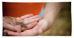A Young Girl Holds A Small Lizard Beach Towel