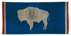 Aged Wyoming State Flag Beach Towel by Dan Sproul