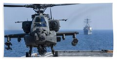 An Army Ah-64d Apache Helicopter Takes Beach Towel