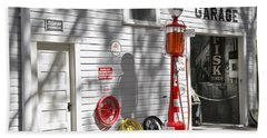 An Old Village Gas Station Beach Towel by Mal Bray