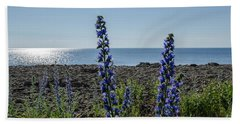 Backlit Blue Flowers  Beach Towel