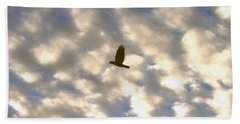 Beach Sheet featuring the photograph Bird Across Macerel Clouded Sky by Jay Milo