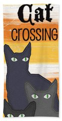 Black Cat Crossing Beach Towel