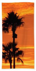 Beach Towel featuring the photograph Blazing Sunset by Deb Halloran