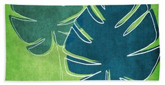 Blue And Green Palm Leaves Beach Towel by Linda Woods