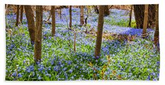 Blue Flowers In Spring Forest Beach Towel