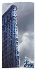Beach Towel featuring the photograph Blue Glow Flatiron Building New York by Tom Wurl
