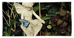Blue Morpho On Statue Beach Towel by MTBobbins Photography