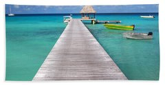 Boats At The Jetty In A Tropical Turquoise Lagoon Beach Sheet