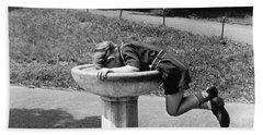 Boy Drinking From Fountain Beach Towel