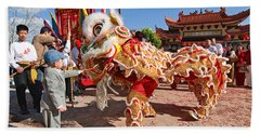 Boy Giving A Red Envelope Gift To A Lion Dancer. Chinese Lion Da Beach Towel