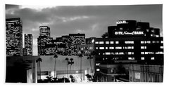 Building Lit Up At Night In A City Beach Towel by Panoramic Images