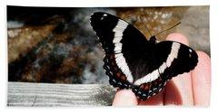Butterfly On Fingertips Beach Sheet