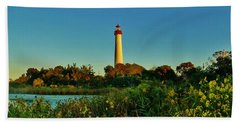 Cape May Lighthouse Above The Flowers Beach Towel