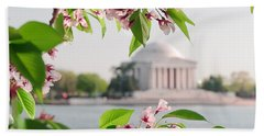 Beach Towel featuring the photograph Cherry Blossoms And The Jefferson Memorial by Mitchell R Grosky