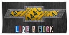 Chevrolet Vintage Logo License Plate Art Like A Rock On Wood Boards Beach Towel