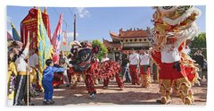 Chinese Lion Dancers During A Celebration. Beach Towel