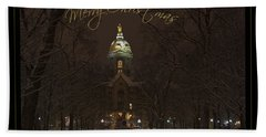 Christmas Greeting Card Notre Dame Golden Dome In Night Sky And Snow Beach Towel