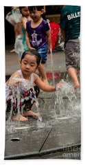 Clothed Children Play At Water Fountain Beach Towel