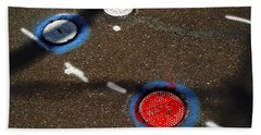 Colorful Storm Drain Covers And White Beach Towel