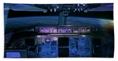 Commercial Airplane Cockpit By Night Beach Towel