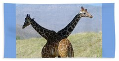 Crossed Giraffes Beach Towel
