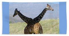 Crossed Giraffes Beach Sheet by Phyllis Kaltenbach