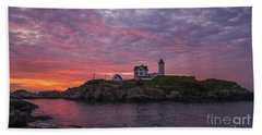 Dawn At The Nubble Beach Towel by Steven Ralser