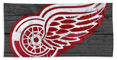 Detroit Red Wings Recycled Vintage Michigan License Plate Fan Art On Distressed Wood Beach Towel by Design Turnpike