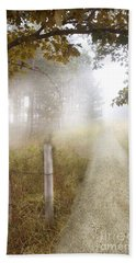 Dirt Road In Fog Beach Towel by Jill Battaglia