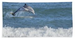 Dolphin In Surf Beach Towel