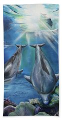Beach Towel featuring the painting Dolphins Playing by Thomas J Herring